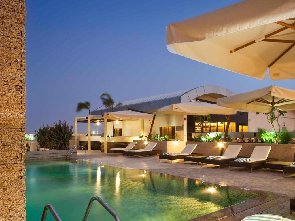 Best price on novotel suites dubai mall of the emirates in - Dubai airport swimming pool price ...