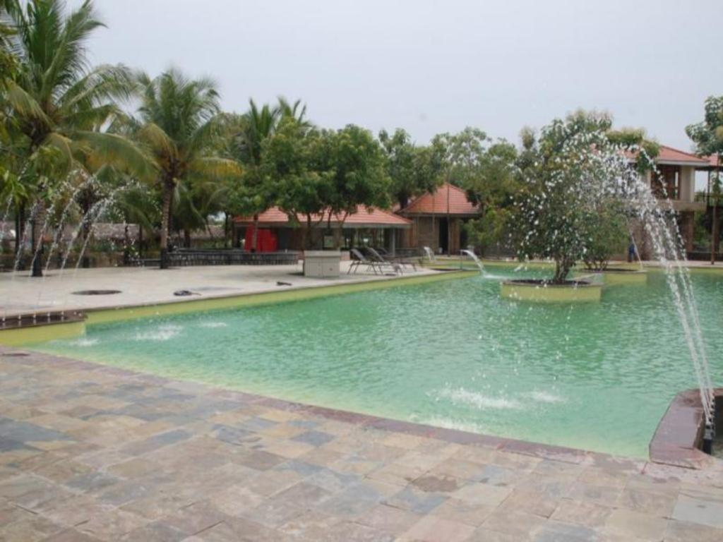 Esthell village resort in chennai room deals photos reviews for Beach resort in chennai with swimming pool