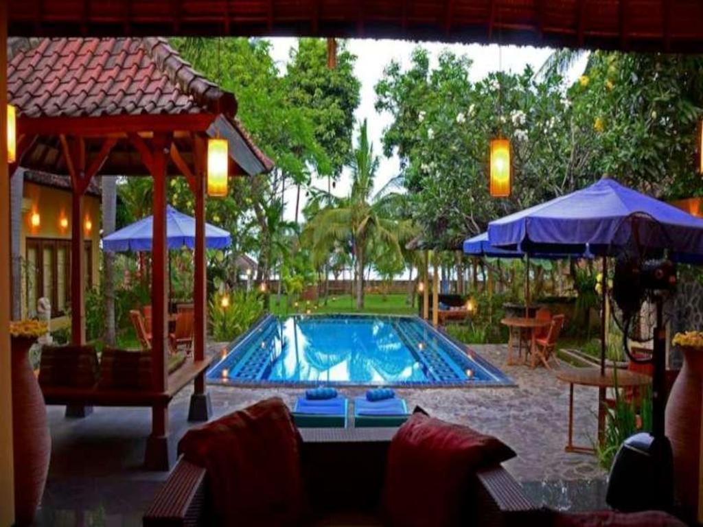 Best Price on Bali au Naturel Beach Resort in Bali + Reviews
