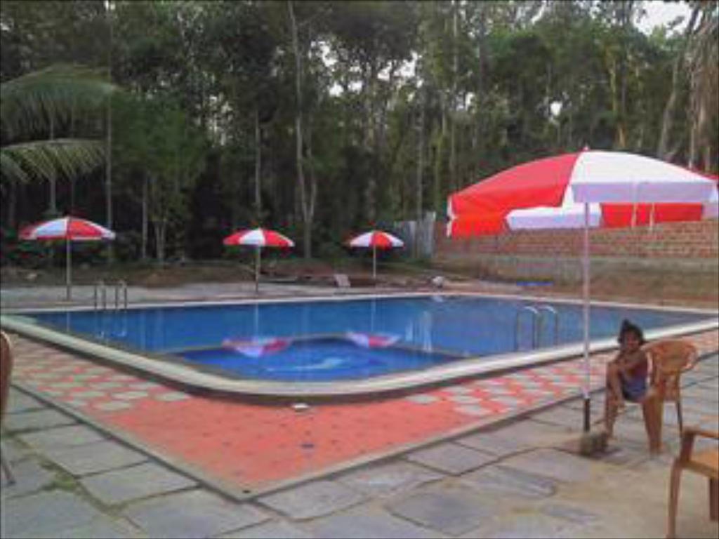 Best price on coorg coffee flower resort in coorg reviews Hotels in coorg with swimming pool
