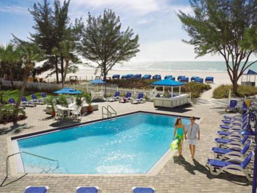Best price on guy harvey outpost a tradewinds beach for Swimming pool trade show florida