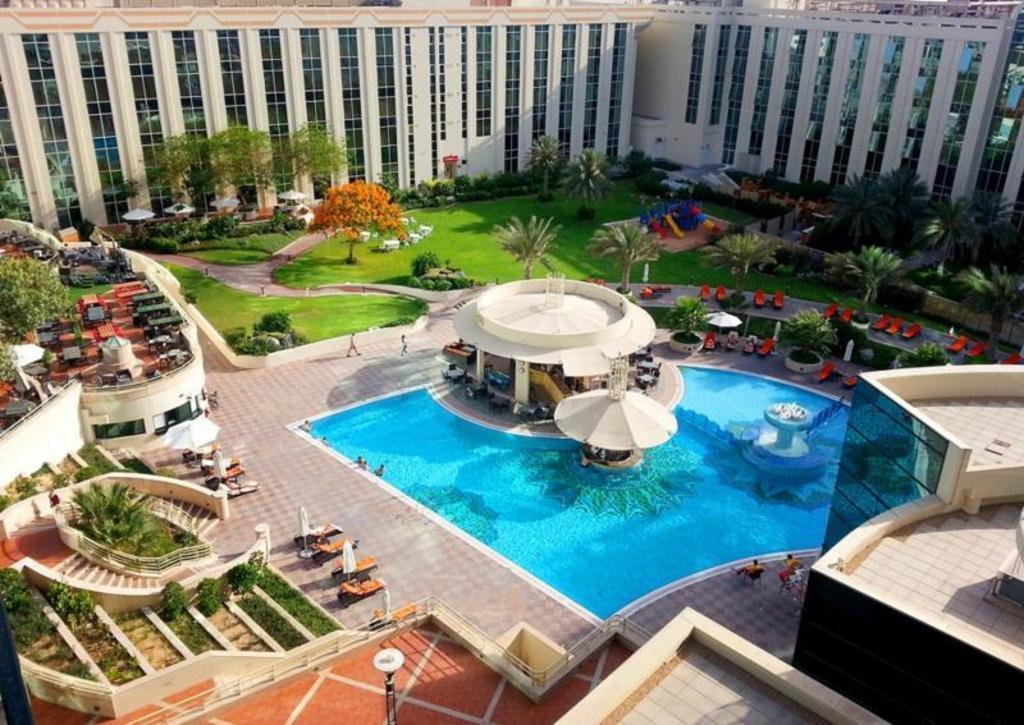 Best price on millennium airport hotel dubai in dubai - Dubai airport swimming pool price ...