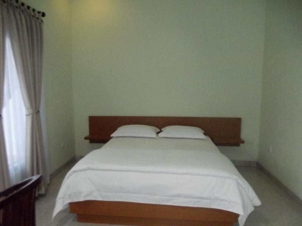 Deluxe Twin With Balcony - Bed Komodo Boutique Hotel