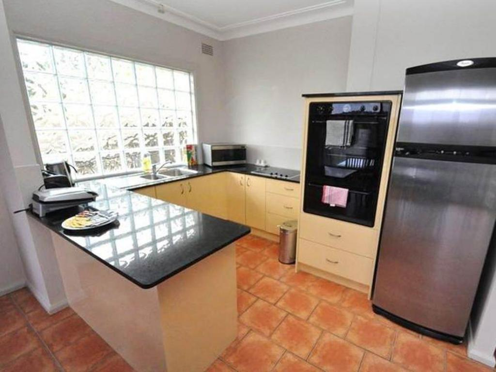 kitchen North Ryde Furnished Apartments 69 Melba Drive