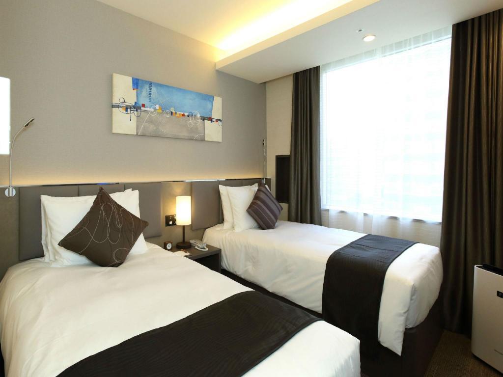 Twin Room - Guestroom Oakwood Hotel & Apartments Shin-Osaka