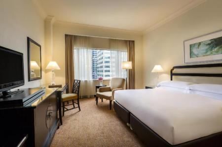 Deluxe King Room - Bedroom Mandarin Orchard Singapore