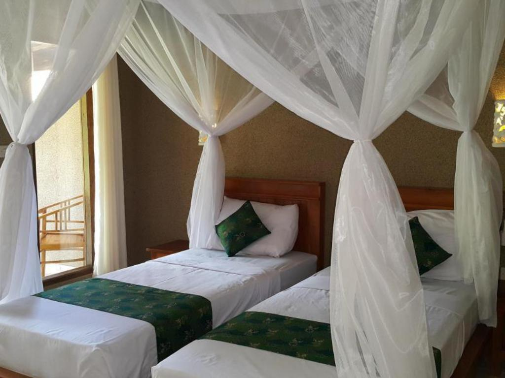 Double or Twin Room with Terrace - Bed Mango Tree Inn