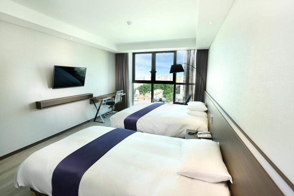 Standard Family Twin - Tempat tidur Hotel The One