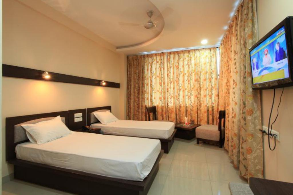 Super Deluxe Double  or Twin Room - Kamar tidur Hotel Madhurima