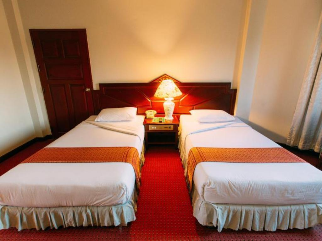Hotellet indefra Inn Come Hotel