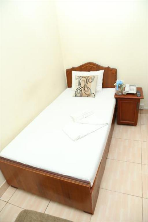Kamar Standard Single - Tempat tidur BRIGHT INN Luxury Holiday Resort
