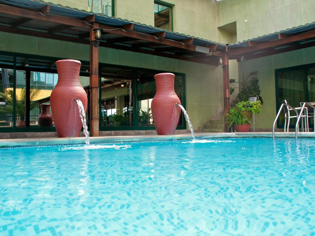 Best price on hotel harbourview suites in dar es salaam tanzania for Swimming pools in dar es salaam