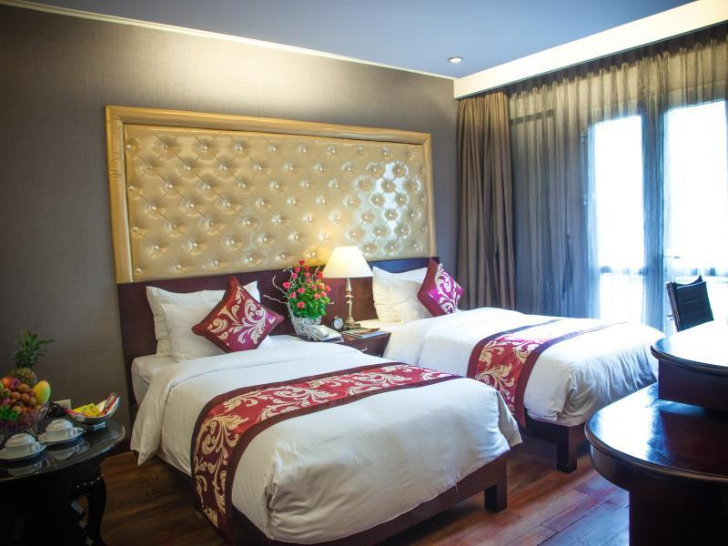 Kamar Deluxe Double atau Twin dengan Balkon (Deluxe Double or Twin Room with Balcony)