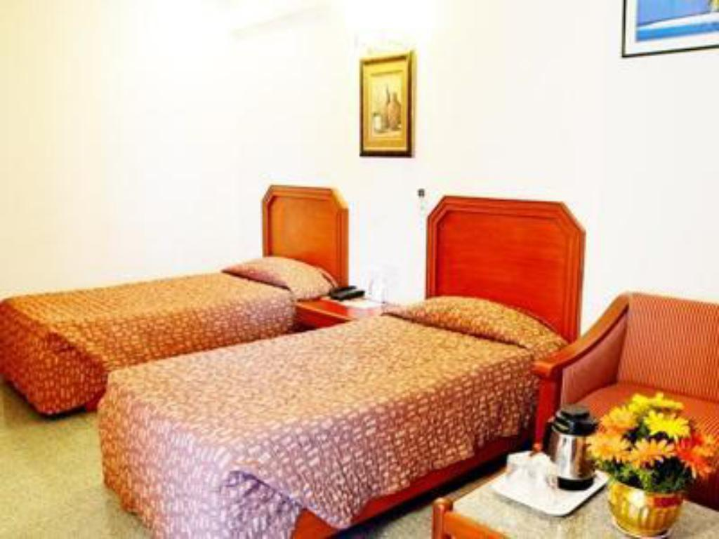 Standard AC Room - Bed Hotel Chalukya