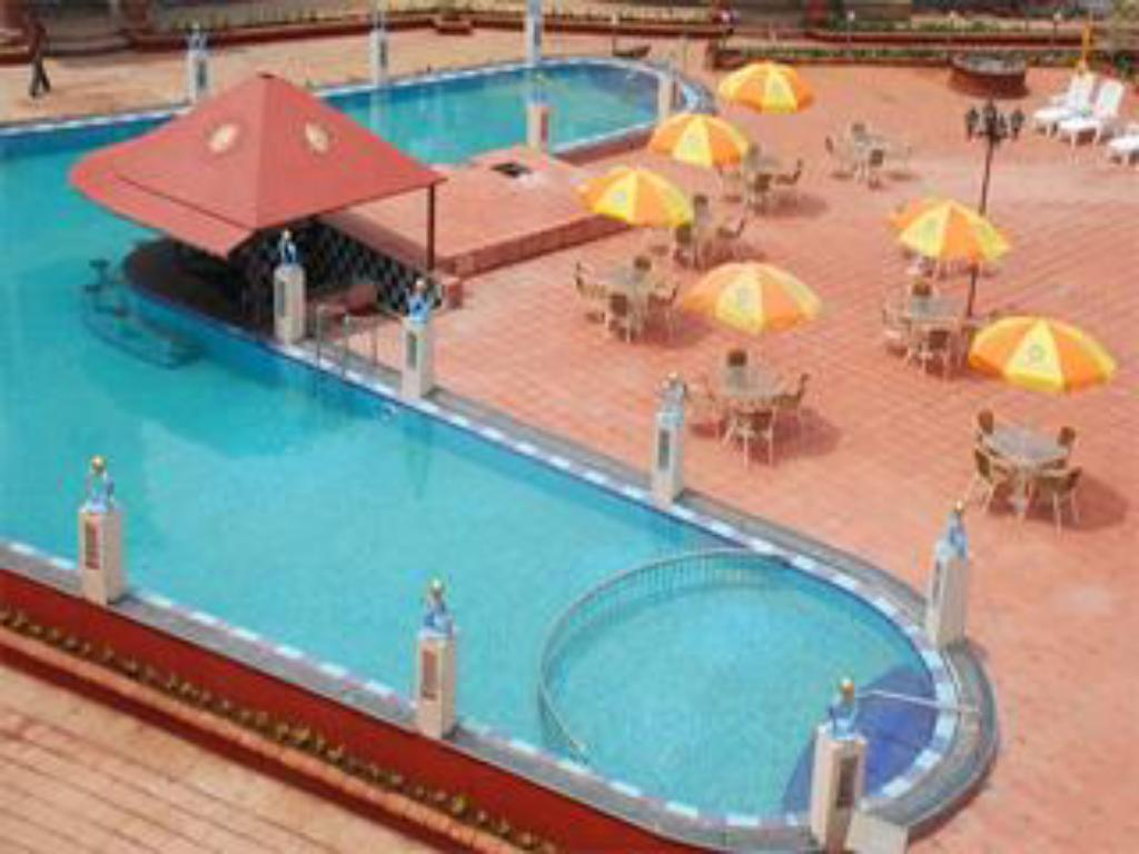 Sun city resort in goa room deals photos reviews for Resorts in goa with private swimming pool