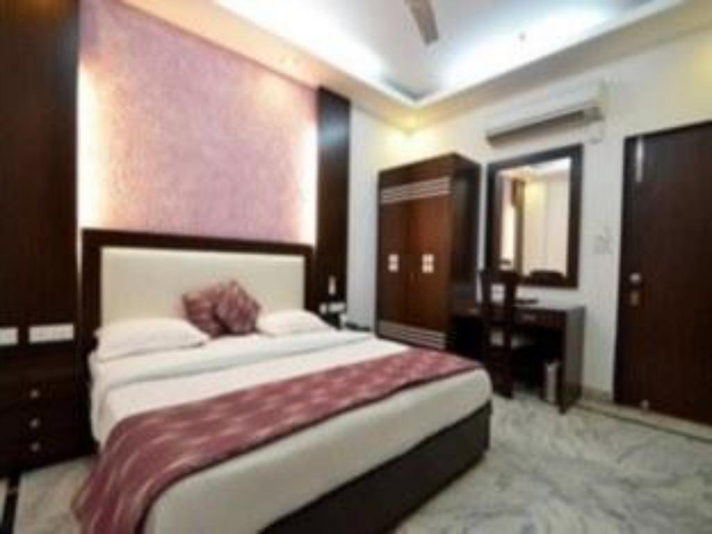 Executive Room - Bed Hotel Swagath