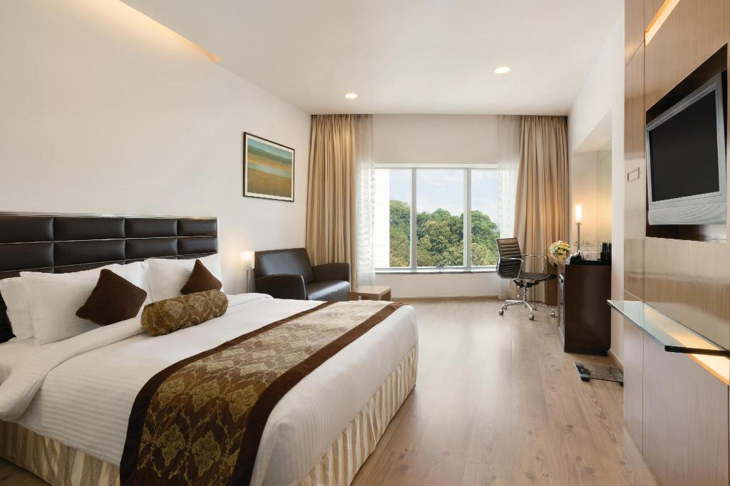 1 King Bed Deluxe Room - Bed Ramada by Wyndham Powai Hotel & Convention Centre