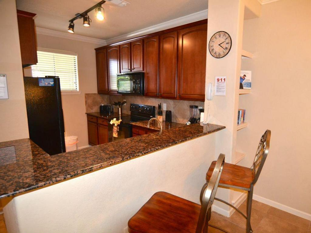 2 Bedroom Condo - Kitchen Bella Piazza Condo at 903 Charo Parkway