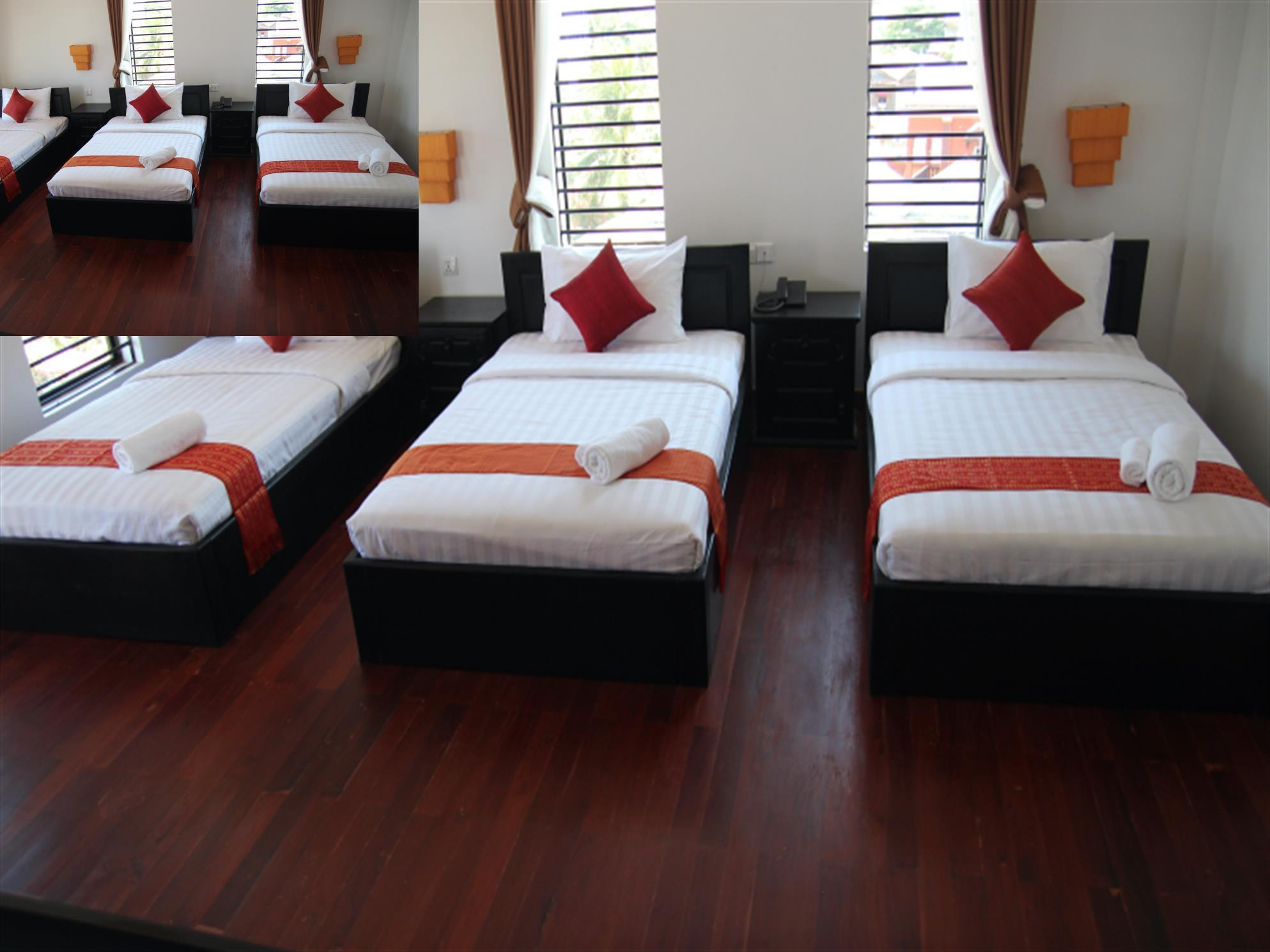 Deluxe Triple Room with Balcony and City View