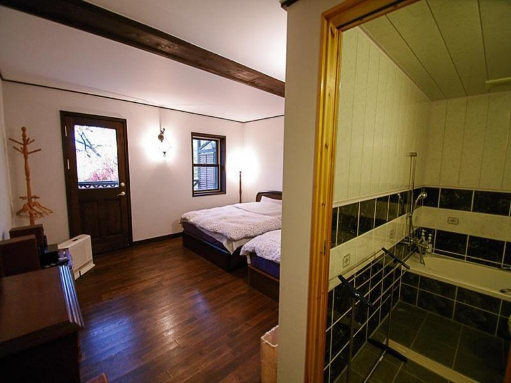 Superior med 2 enkeltsenge Petit Hotel of Log House Tombouctou