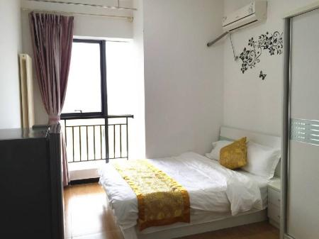 Camera con Letto Matrimoniale Queen Size Beijing JM Family Apartment