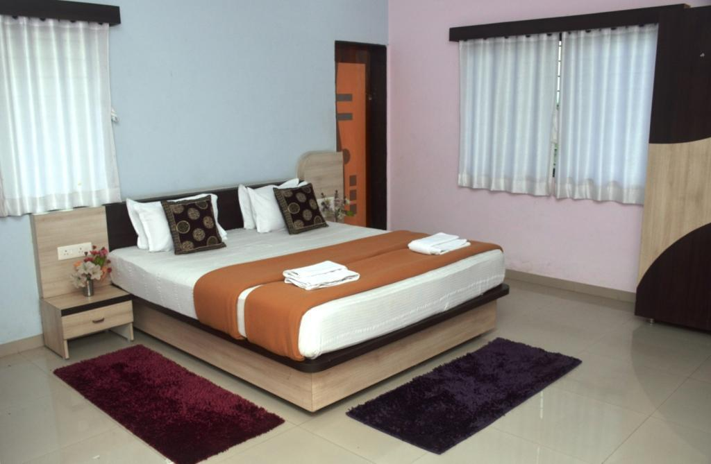 Deluxe Double Room with Fan - Bed