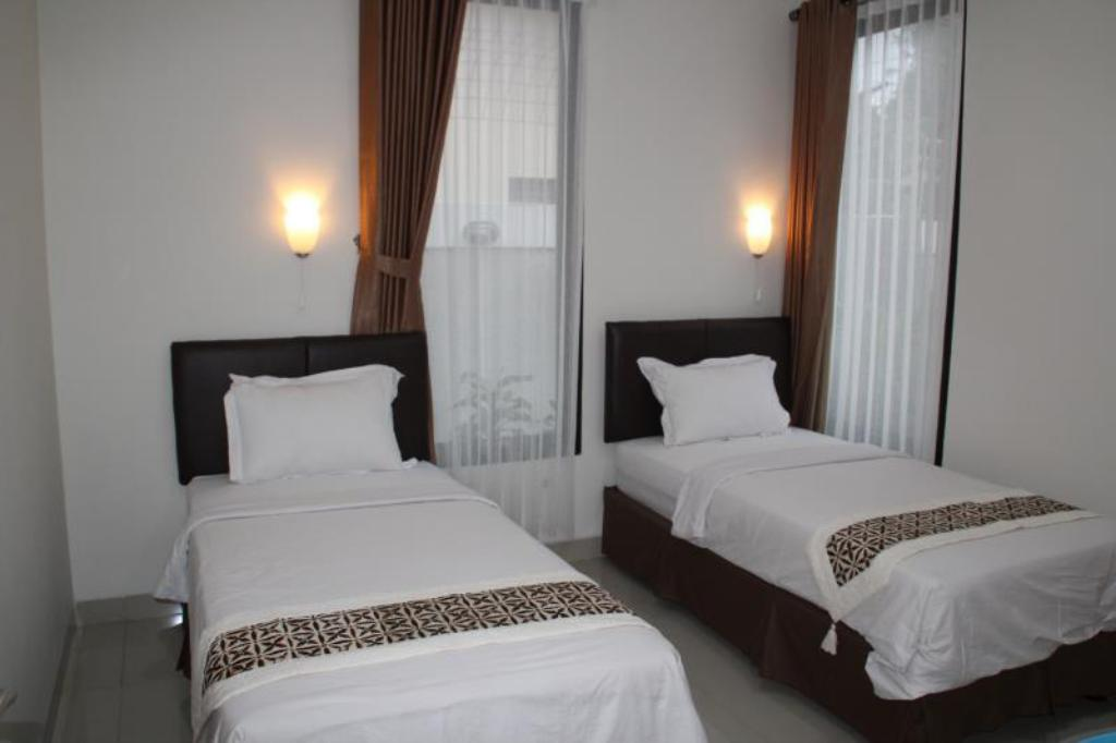 Twin bed Natura Rumah Singgah (Boutique Guest House)