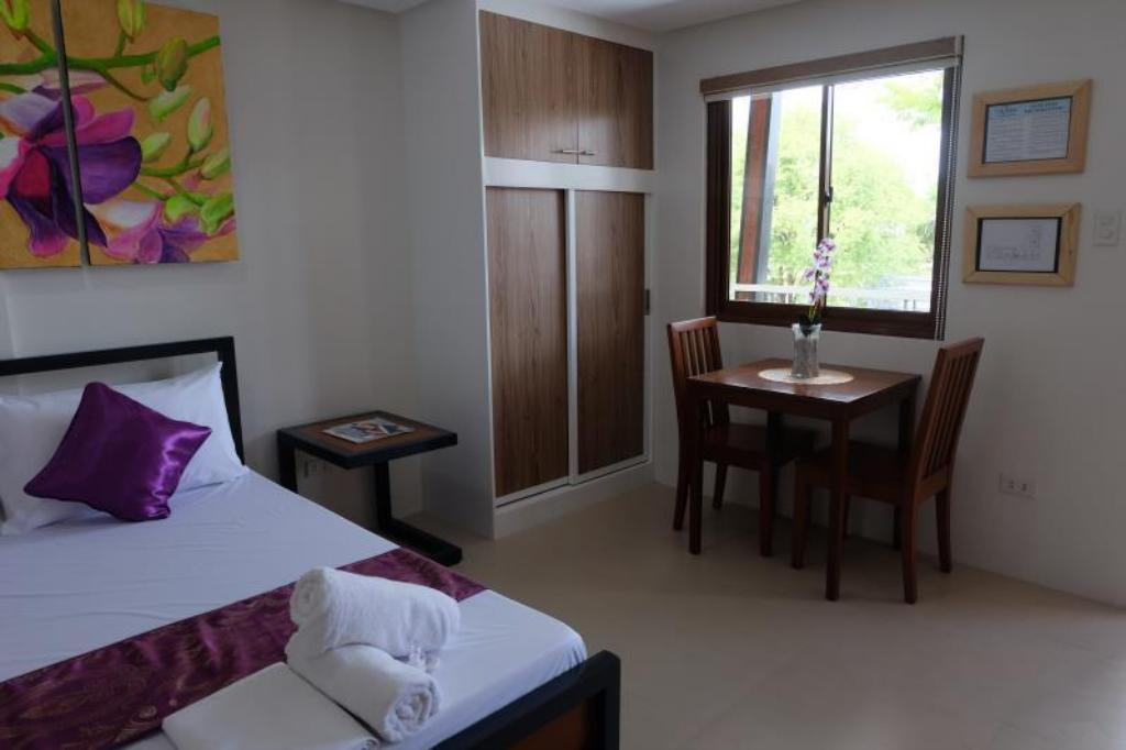 1270480 16072515350044909875 - The Tavern Orchid Gardens Room Rates