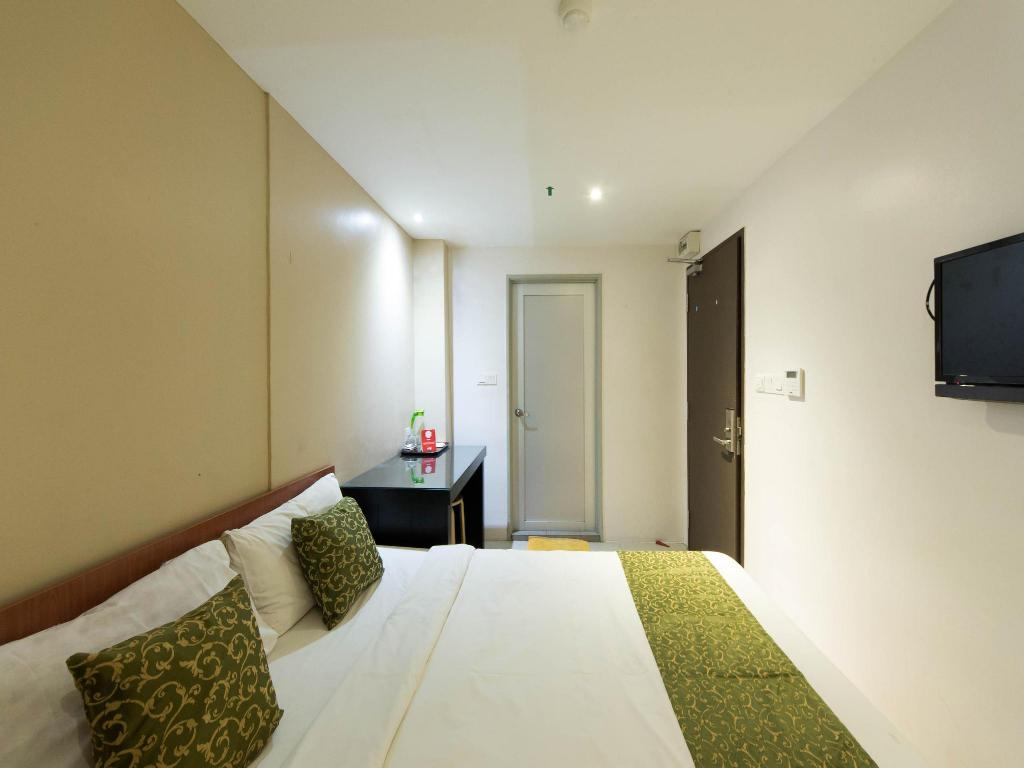Double or Twin Room with Private Bathroom OYO 152 Swiss Cottage Hotel