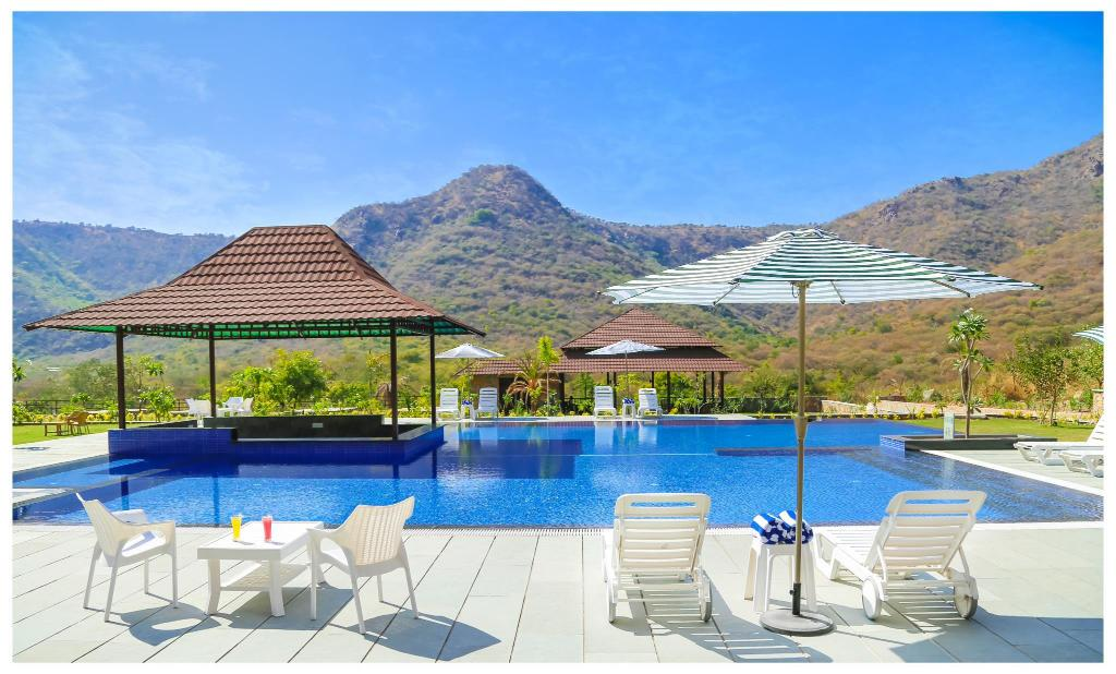 Tree leaf vantara resorts spa udaipur india photos room rates promotions for Hotel in udaipur with swimming pool