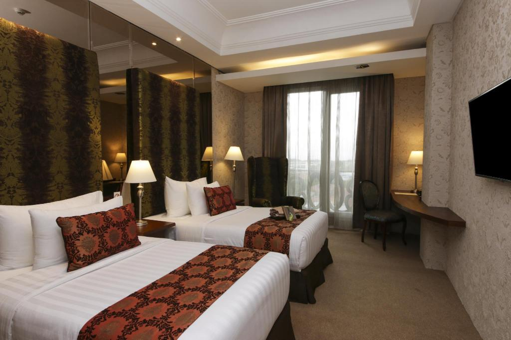 Deluxe Twin Bed Cinnamon Hotel Boutique Syariah