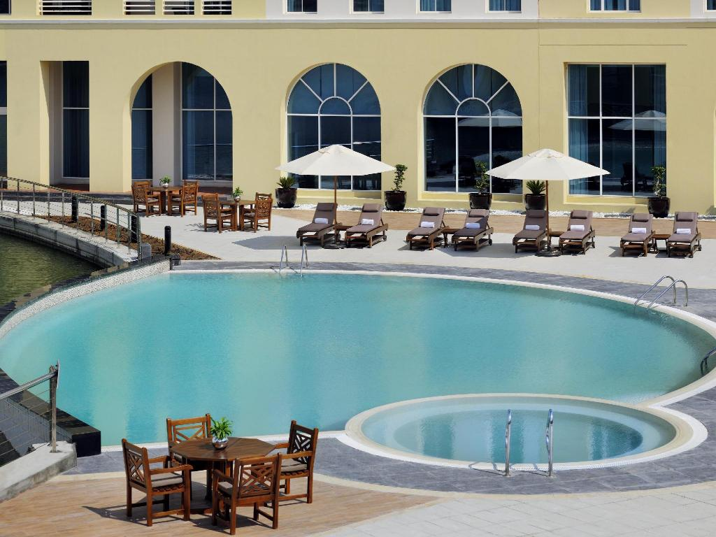 Best Price On Courtyard By Marriott Dubai Green Community In Dubai Reviews