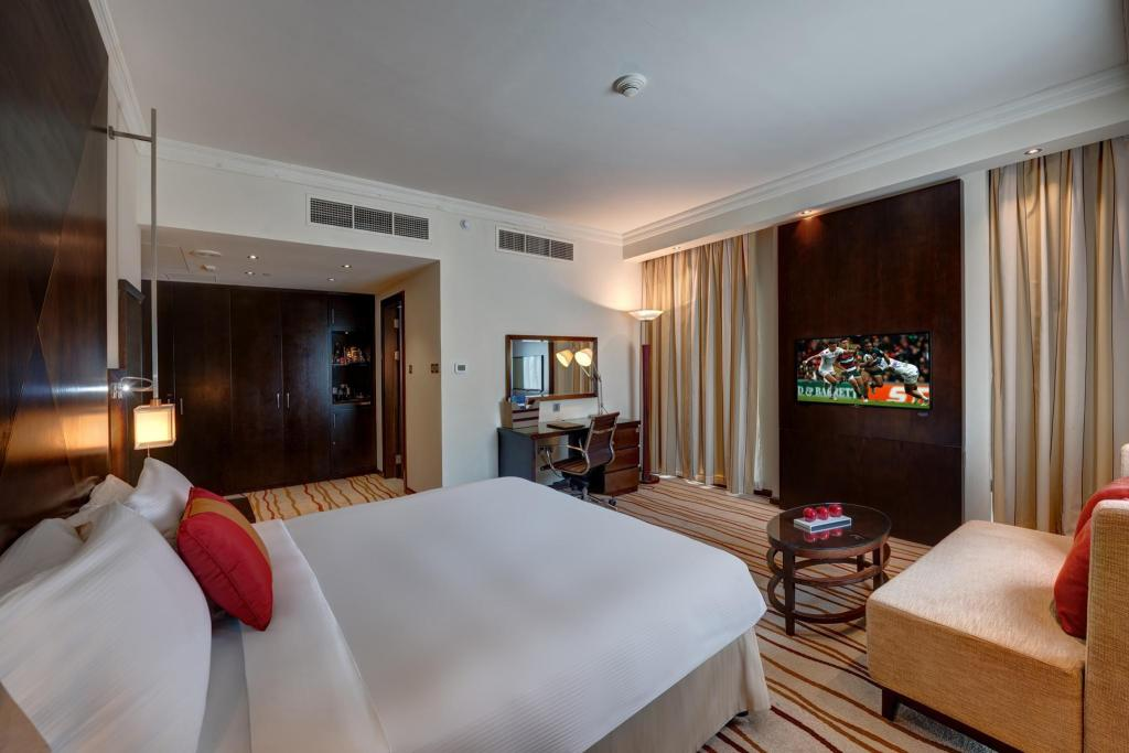 King Classic Room - Bed Media Rotana Dubai