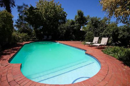 Swimming pool [outdoor] Whispering Oaks Guest House