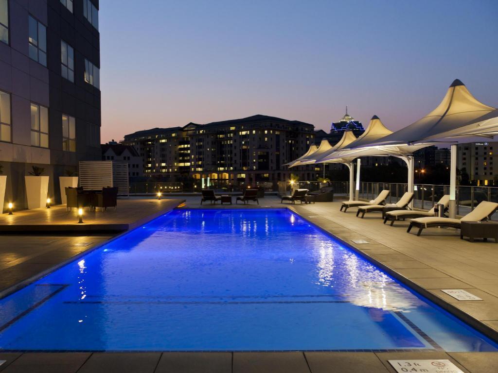 Best price on radisson blu hotel sandton johannesburg in johannesburg reviews for Public swimming pools in johannesburg