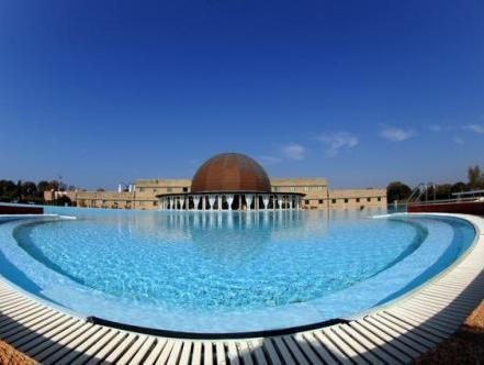 Cosmopolitan golf beach resort in tirrenia room deals photos