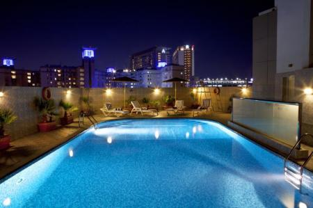 Swimming pool [outdoor] Landmark Riqqa Hotel