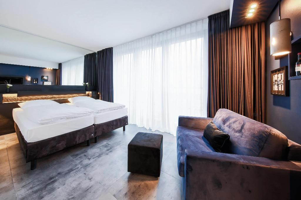 Chambre « Streetlife and Big » - Equipements LINDEMANN'S Hotel