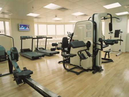 Fitness center Number One Tower Suites Hotel