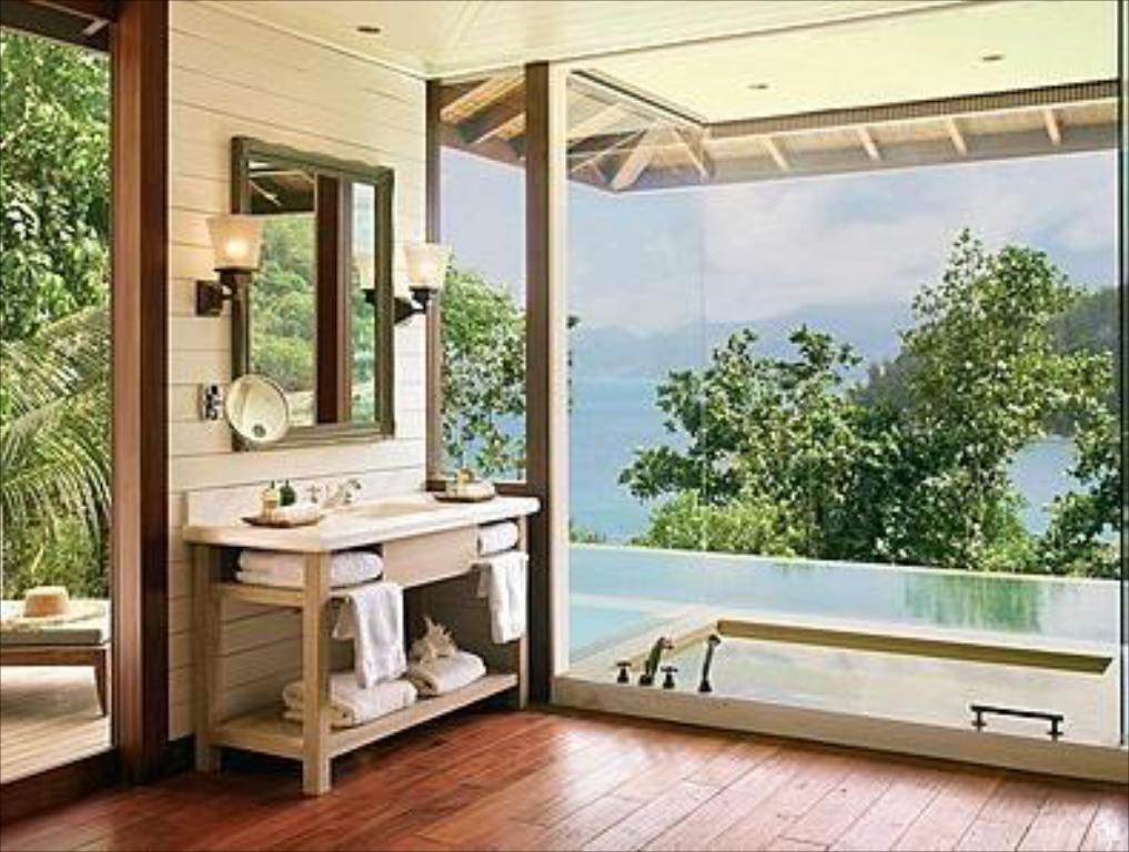 חדר אורחים - מרפסת Four Seasons Resort Seychelles