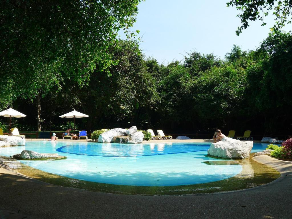 Swimming Pool Sunset Village Beach Resort