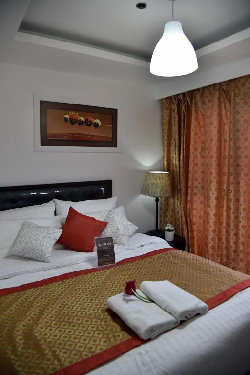 Deluxe - Bed Sea Pearl Manila Suites (sea pearl realty management corporation)
