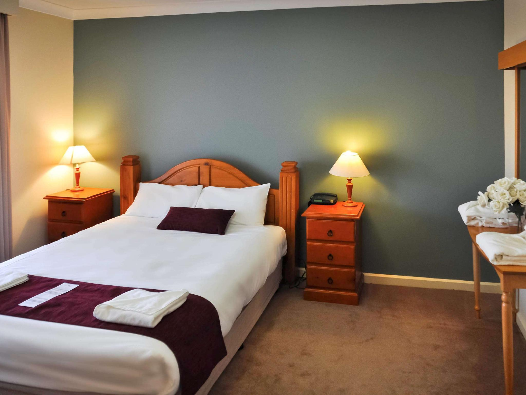 Superior Room with 1 queensize bed and 2 single beds