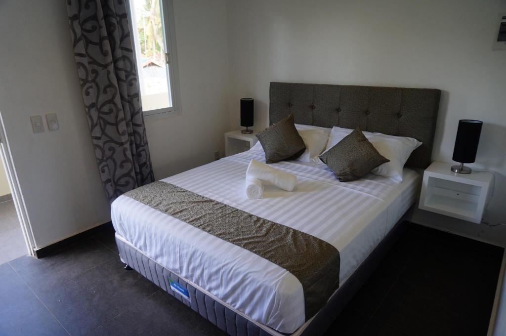 Standaard- Queensize kamer - Bed Malinawon Resort