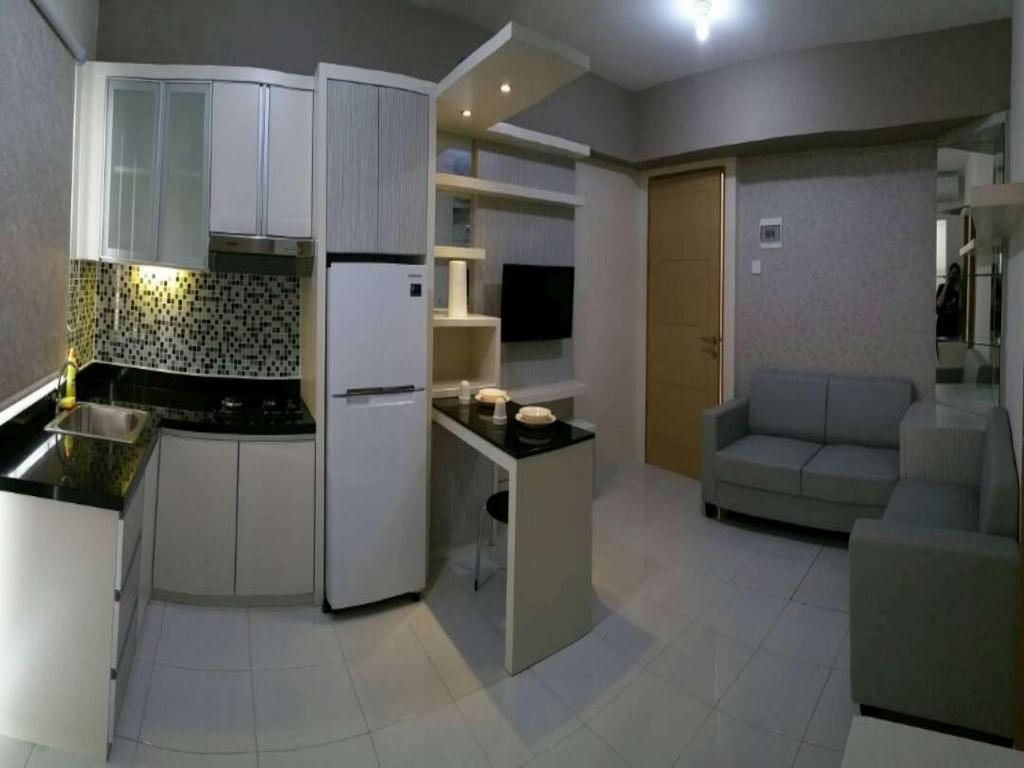 2 BR Corner Harvard Tower 1 at Educity Apartment by IPR