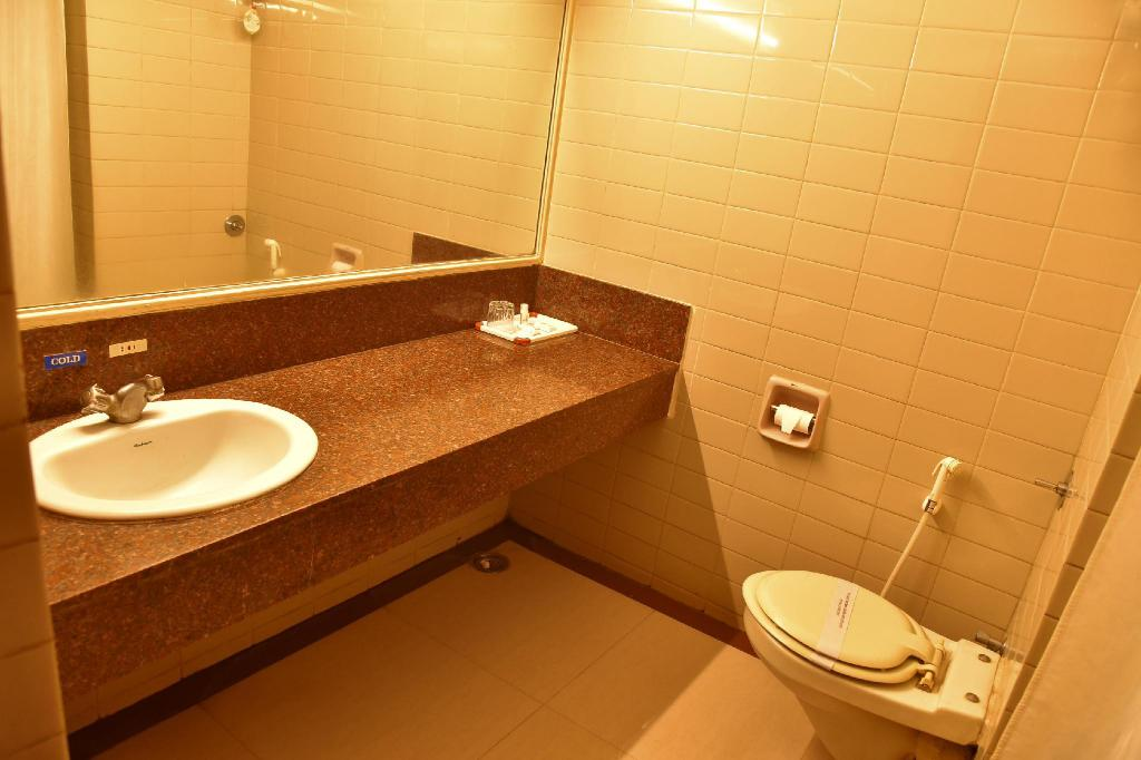 Hotel Poonja International in Mangalore - Room Deals, Photos