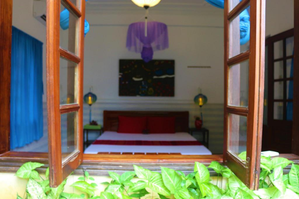 Double Room with Garden View - Interior view Under The Coconut Tree Old Town Hostel