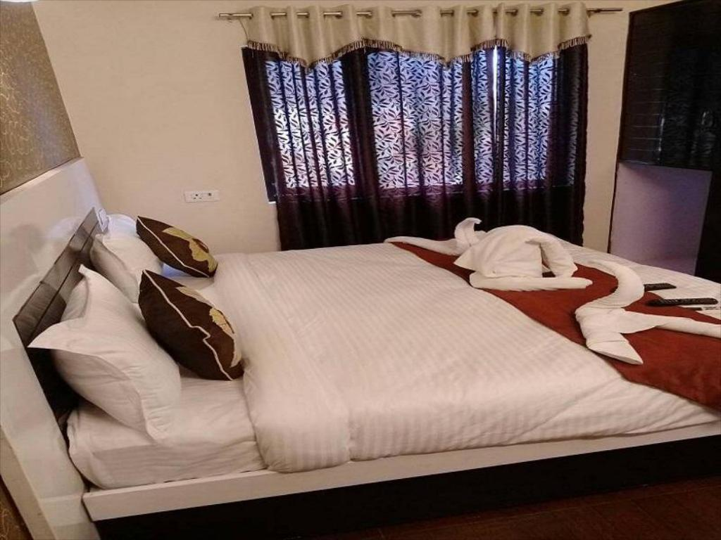 Deluxe - Bed Hotel Sparsh Ganga