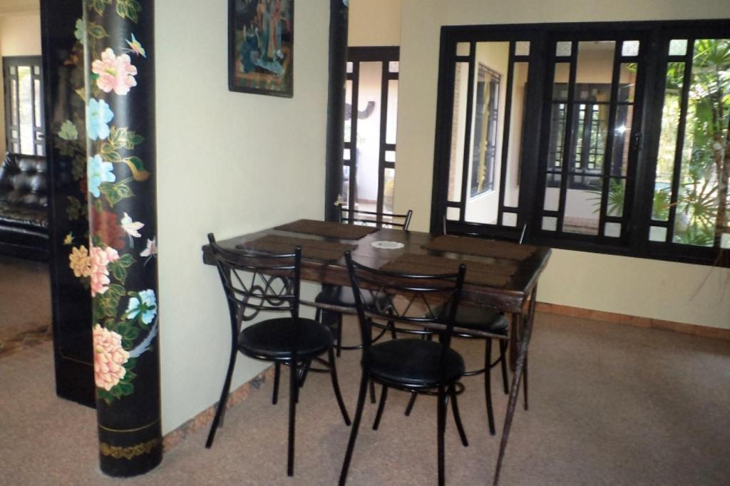 Dining room/area Paradise  Rentals Villa -Shared Salt-Water Pool