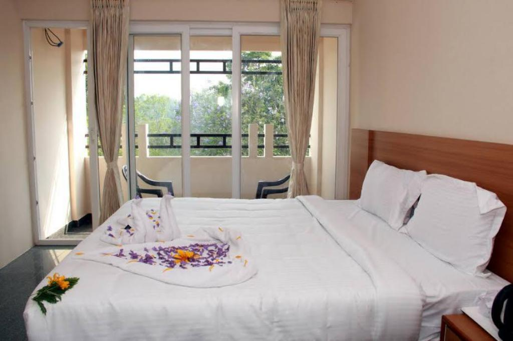 Supreme Room - Bed ACK Palacce Inn - Yercaud